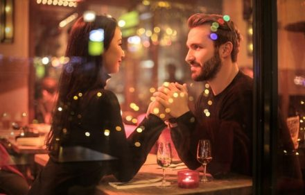 Couple holding hands in sparkling lite