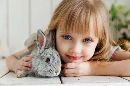 Little girl with a bunny
