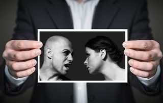black and white photo of a couple being held by someone