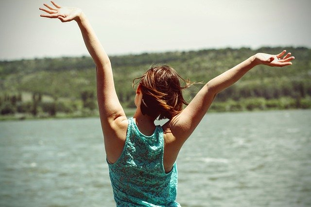 happy woman feeling free arms up