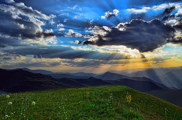 blue sky with clouds and suns rays