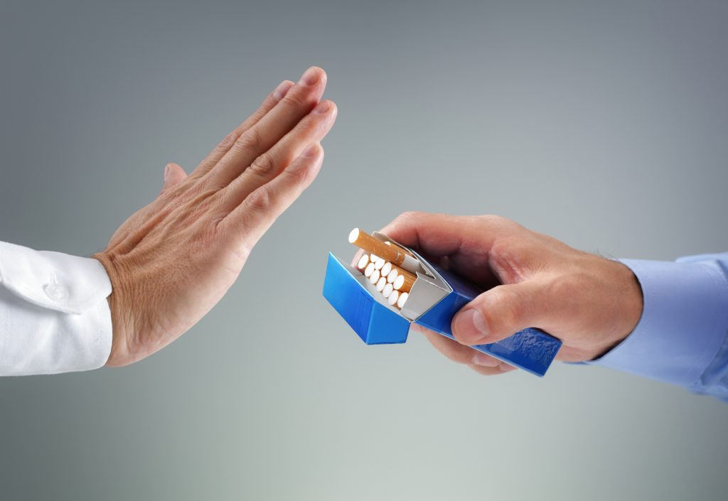 hand saying no to offer for cigarette