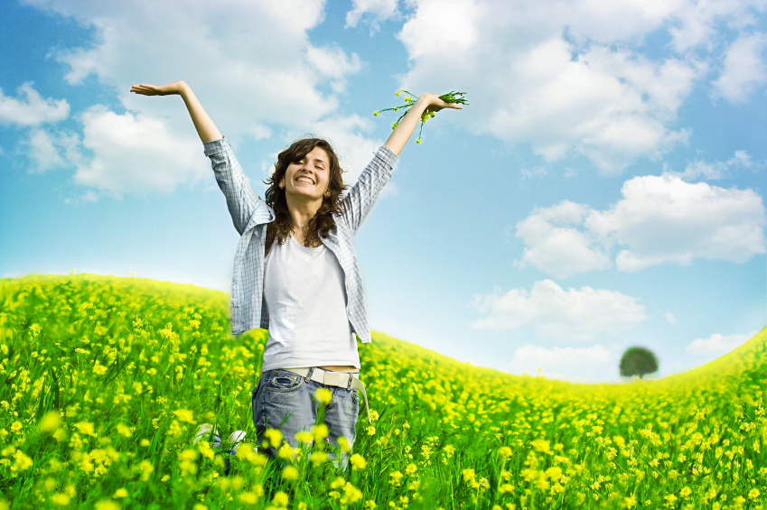 happy slender woman with arms up in air