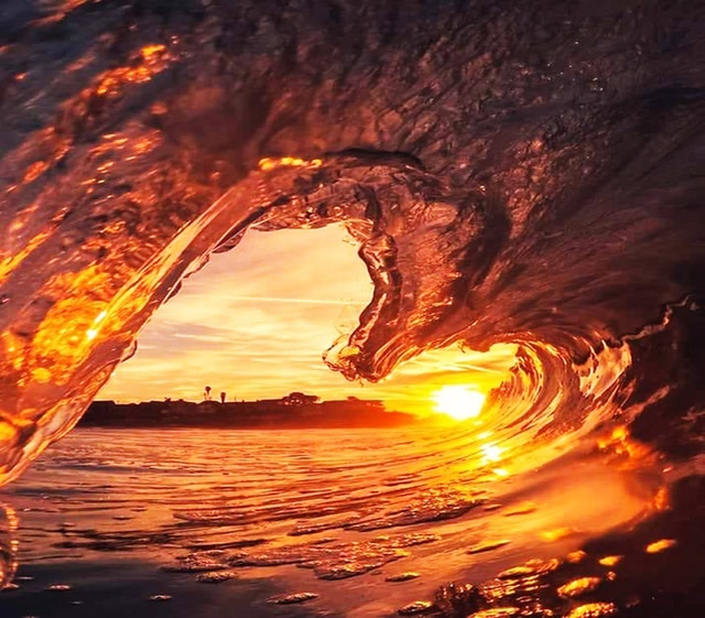 golden sun reflecting on a wave