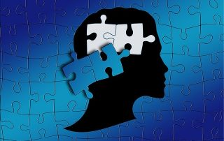 dark puzzle of a head with missing piece
