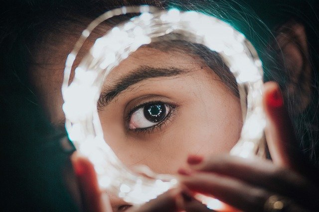 girls eye up close with lights around it