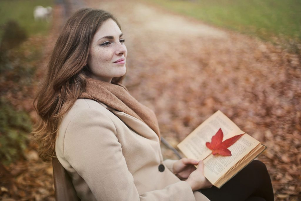 Woman relaxing reading a book