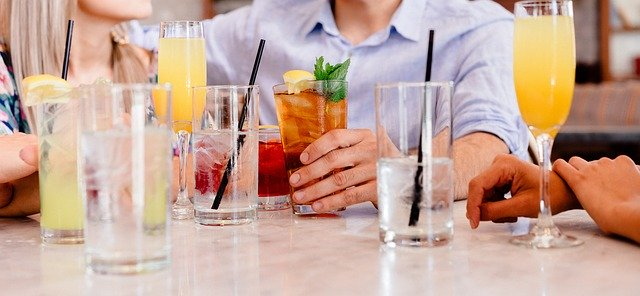 people drinking beverages at a restaurant
