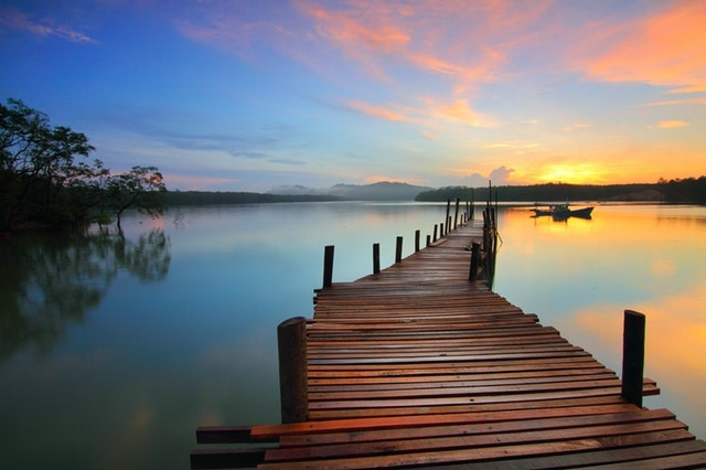 boardwalk on a lake with sunset