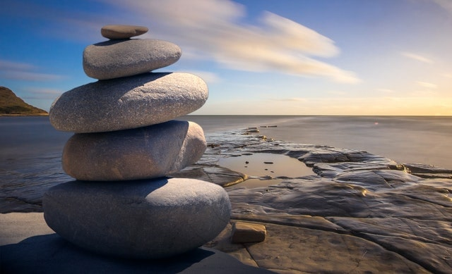 stones stacked by a river